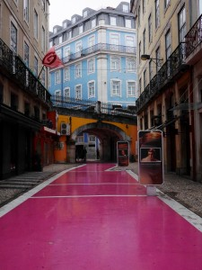 Pink street Lisbon Portugal on a rainy day thesweetwanderlust.com