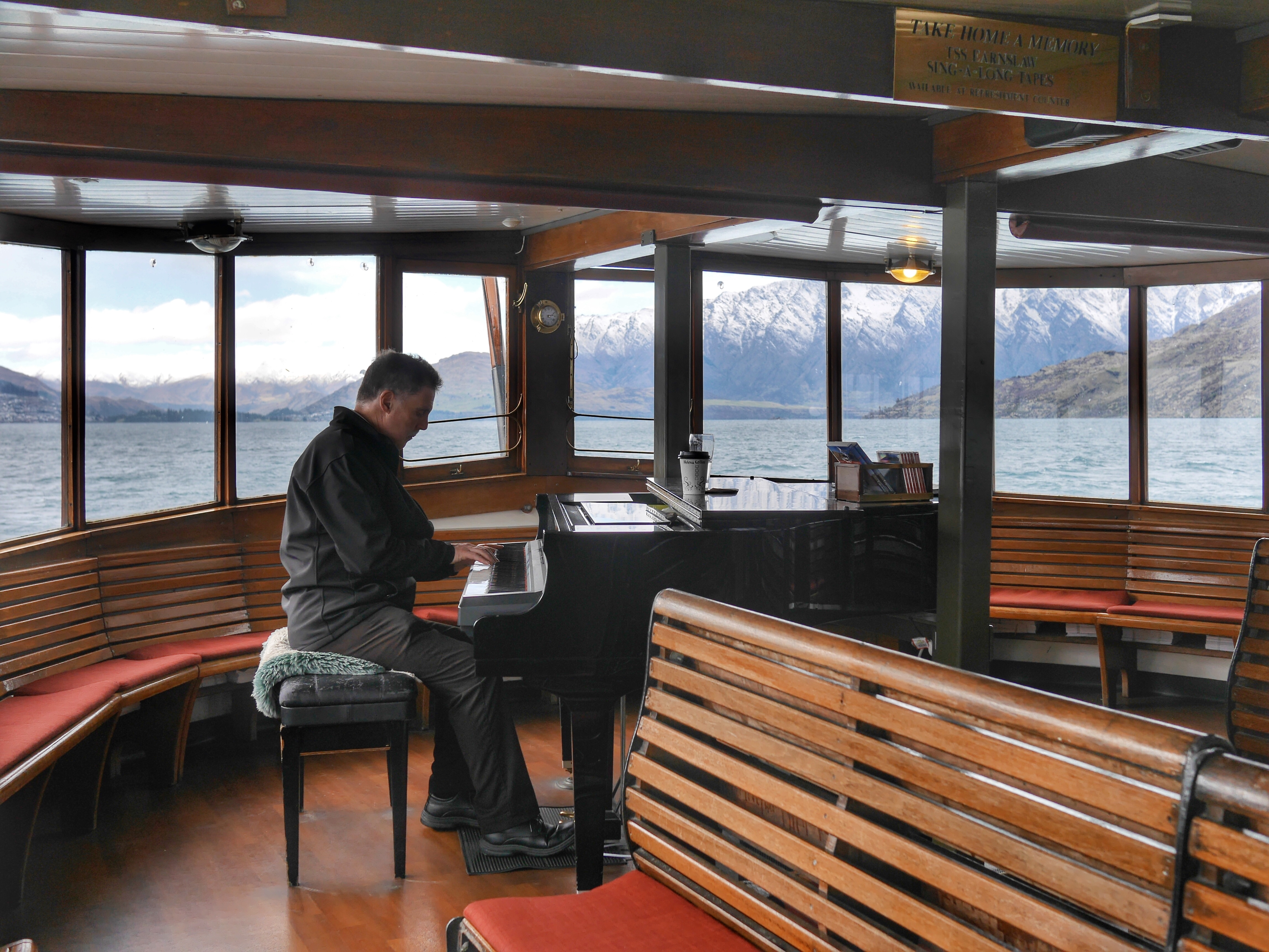 Pianist on TSS Earnslaw on Lake Wakatipu thesweetwanderlust.com
