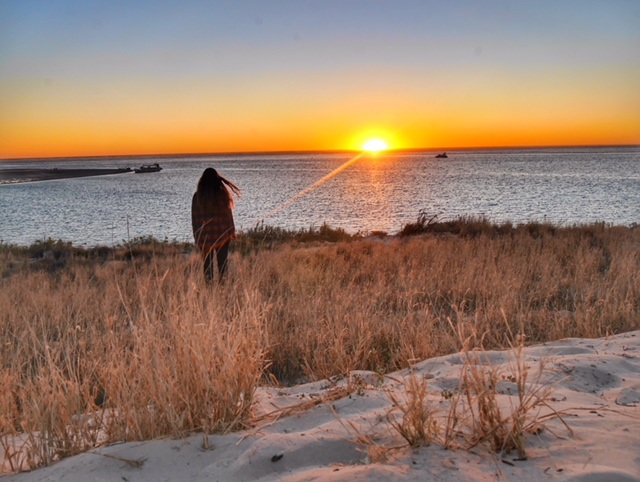 Watch a sunset from the dunes in Coral Bay
