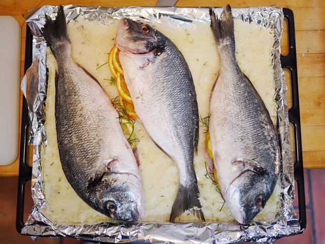 Salt crusted fish stuffed with oranges and lemons