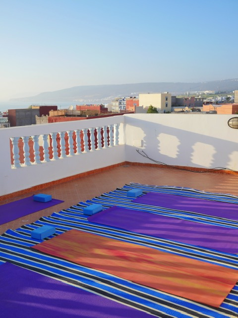 Azrac Surf and Yoga Retreat Morocco rooftop yoga at sunset