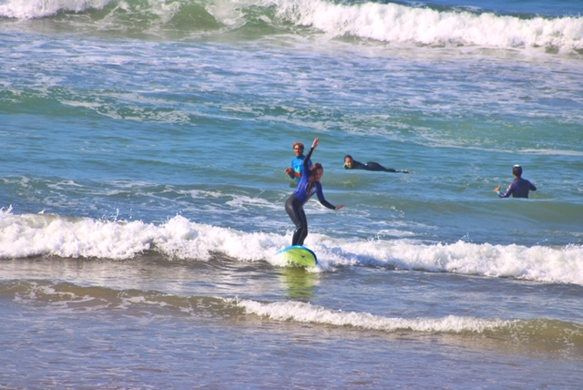 Catching a wave at Azrac Surf Camp Morocco