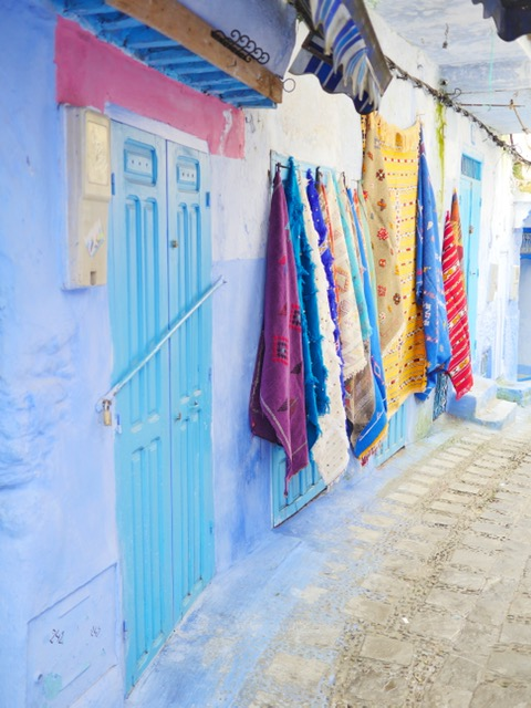 Chefchaouen - the blue city of Morocco - carpets and blue walls